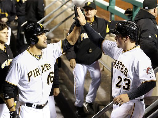 McKenry's 2 HRs help Pirates rally past Reds 10-7