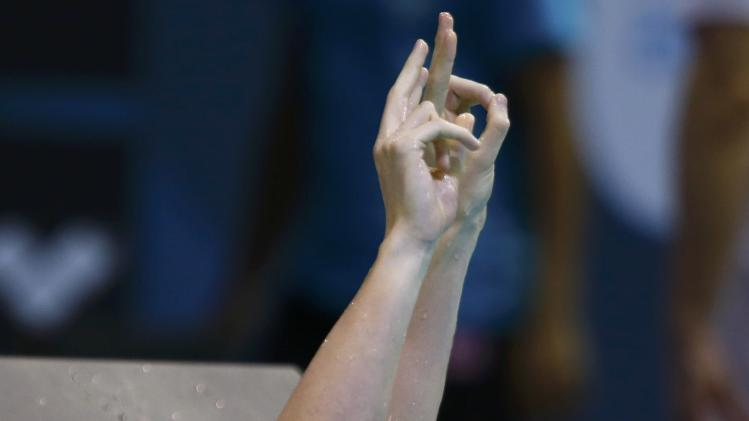 Koch of Germany celebrates after winning the men's 200m breaststroke final at the European Swimming Championships in Berlin