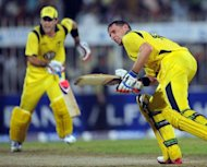 Australia's Michael Hussey (R) and Glenn Maxwell score runs during the third and last One Day International cricket match between Pakistan and Australia at the Sharjah cricket stadium. Hussey and Maxwell hit fighting half-centuries to help Australia beat Pakistan by three wickets in the third and final one-day international, taking the three-match series 2-1 here on Monday