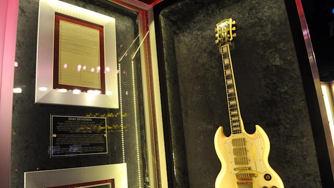 "Jimi Hendrix' 1967 Gibson SG Custom guitar is on display at Hard Rock International's traveling music memorabilia tour, ""Gone Too Soon,"" at Hard Rock Cafe New York, Wednesday, Feb. 13, 2013. ""Gone Too Soon"" pays tribute to music icons whose lives and career where tragically cut short and will be on tour at Hard Rock locations in the U.S. throughout 2013. (Photo by Diane Bondareff/Invision for Hard Rock International/AP Images)"