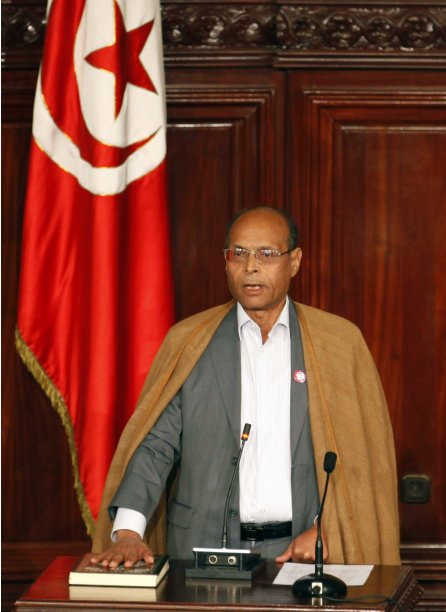 Tunisia's President Moncef Marzouki takes the oath of office at the constituent assembly in Tunis