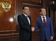 Russia President Dmitry Medvedev (right) shakes hands with visiting Chinese Vice Premier Li Keqiang during a meeting in the Gorki residence outside Moscow. Li, China's likely next premier praised a new Russia as he flew to Moscow for meetings with its leaders amid power transition in both countries