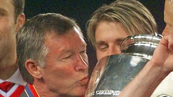 FILE - In this Wednesday, May 26, 1999 file photo Manchester United manager Alex Ferguson kisses the trophy after winning the Champions League final soccer match at the Nou Camp Stadium in Barcelona, Spain. Manchester United beat Bayern Munich 2-1. Manchester United said Wednesday May 8, 2013 that manager Alex Ferguson is retiring at the end of season. (AP Photo/Adam Butler, File)