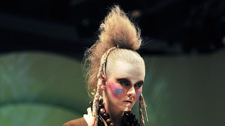 A model wears a creation during the CIFF Press Show during Copenhagen Fashion Week spring/summer 2012 at Bella Center in Copehagen on Wednesday, Aug 3, 2011. Copenhagen Fashion Week continues until Sunday. (AP Photo/POLFOTO, Mik Eskestad)  DENMARK OUT
