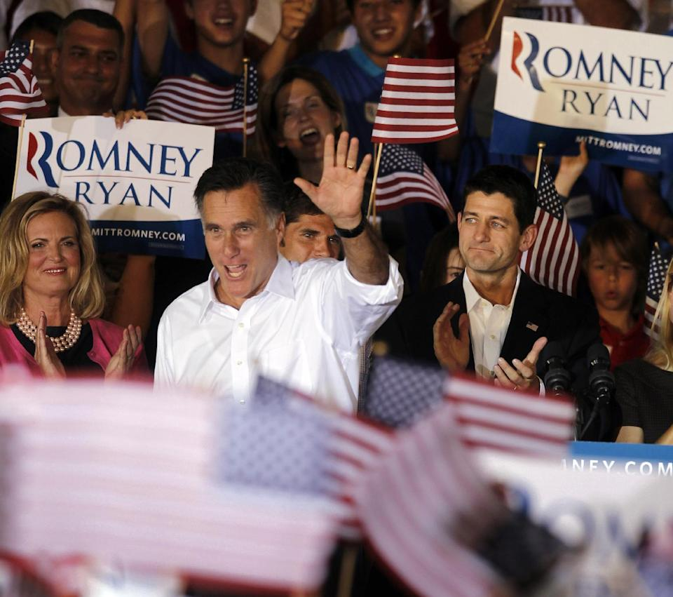 Republican presidential candidate, former Massachusetts Gov. Mitt Romney, center with his wife Ann, left, and his newly announced vice presidential running mate, Rep. Paul Ryan, R-Wis., right, during a campaign rally in Manassas, Va., Saturday, Aug. 11, 2012. (AP Photo/Pablo Martinez Monsivais)
