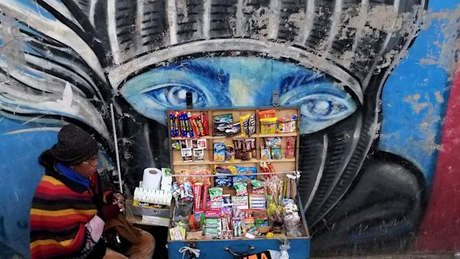 A street vendor sells candies and cigarettes in the centre of  La Paz