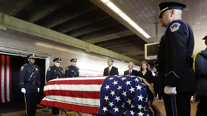The casket of U.S. Sen. Frank Lautenberg is transferred to an Amtrak train en route to Washington D.C. during a Color Guard ceremony at the Frank R. Lautenberg Rail Station Wednesday, June 5, 2013, in Secaucus, N.J. Lautenberg, a Democrat from New Jersey, died Monday at age 89 of complications from viral pneumonia. He was remembered at his funeral at a New York City synagogue Wednesday as a tenacious champion of several causes including the environment and mass transit. Congress voted in 2000 to rename the station the Frank R. Lautenberg Secaucus Junction Station. (AP Photo/Frank Franklin II)