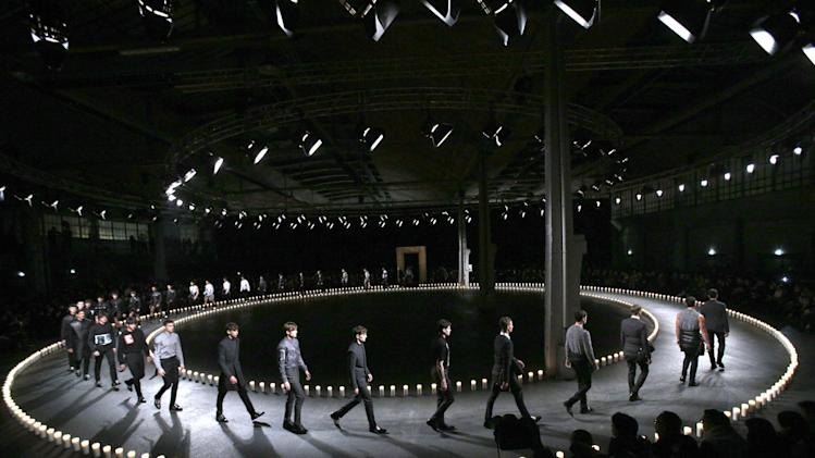 Models present creations by designer Riccardo Tisci for Givenchy as part of his men's fall-winter 2013/2014 fashion collection, presented in Paris, Friday, Jan. 18, 2013. (AP Photo/Christophe Ena)