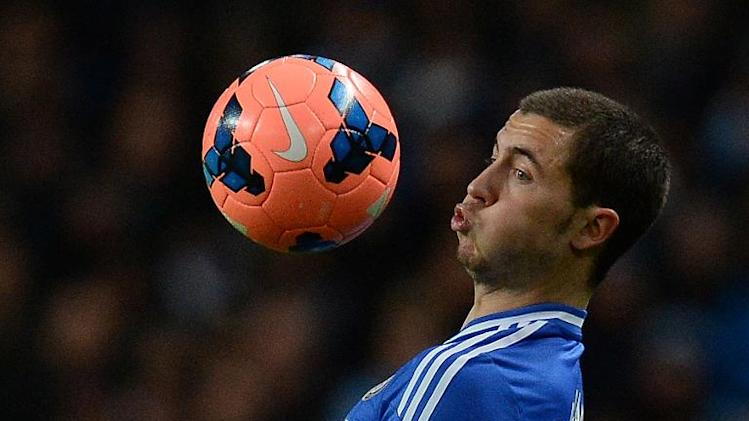 Chelsea's Eden Hazard controls the ball during their English FA Cup match against Manchester City, at The Etihad Stadium in Manchester, on February 15, 2014