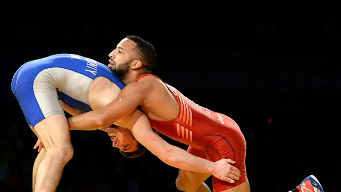 (R-L) Angel Escobedo of the United States wrestles Sergiy Ratushny of Ukraine in the 57kg class during the 2014 FILA Freestyle Wrestling World Cup at The Forum on March 16, 2014 in Inglewood, California. Escobedo would win the match
