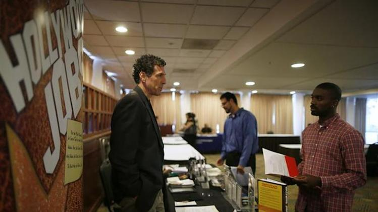 People speak to recruiters at a job fair in Los Angeles, California, November 18, 2013. REUTERS/Lucy Nicholson