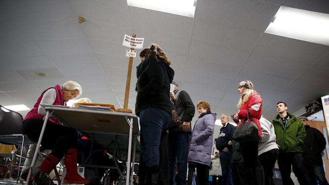 People vote at a polling place at First Baptist Church in Nashua