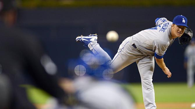 Apr 11, 2013; San Diego, CA, USA; Los Angeles Dodgers starting pitcher Zack Greinke (21) pitches during the first inning against the San Diego Padres at PETCO Park. (Jake Roth-USA TODAY Sports)