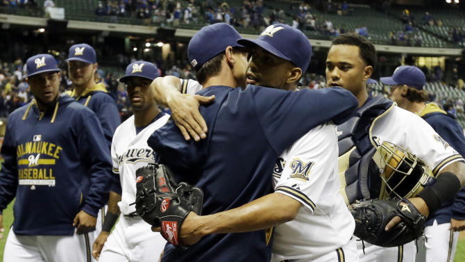 Milwaukee Brewers manager Craig Counsell, center left,  celebrates with Francisco Rodriguez after a baseball game against the Los Angeles Dodgers Monday, May 4, 2015, in Milwaukee. The Brewers won 4-3. (AP Photo/Morry Gash)