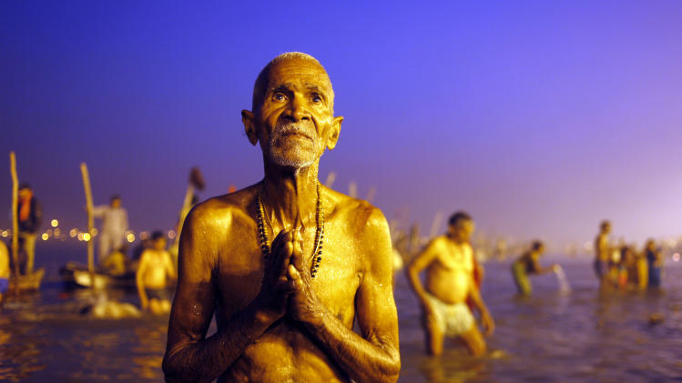 A Hindu devotee prays after a holy dip at 'Sangam', the confluence of Hindu holy rivers Ganges, Yamuna and the mythical Saraswati, during the Maha Kumbh festival at Allahabad, India, Sunday, Feb. 10, 2013.  Led by heads of monasteries arriving on chariots and ash-smeared naked ascetics, millions of devout Hindus plunged into the frigid waters of the holy Ganges River in India on Sunday in a ritual that they believe will wash away their sins. Sunday was the third of six auspicious bathing days during the Kumbh Mela, or Pitcher Festival, which lasts 55 days and is one of the world's largest religious gatherings. (AP Photo /Rajesh Kumar Singh)