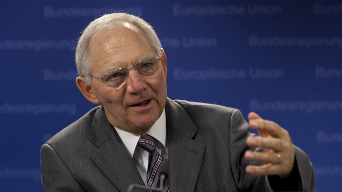 German Finance Minister Wolfgang Schaeuble speaks during a media conference after a meeting of EU finance ministers at the EU Council building in Brussels on Tuesday, Nov. 13, 2012. Shoring up Europe's banking sector and strengthening oversight of economic policies will likely top the agenda of a meeting Tuesday of the European Union's 27 finance ministers. (AP Photo/Virginia Mayo)