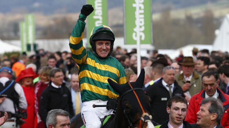 Barry Geraghty on Jezki celebrates as he enters the winners enclosure after winning the Champion Hurdle Challenge Trophy in Gloucestershire