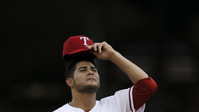 Texas Rangers' Martin Perez prepares to work against the New York Yankees in a baseball game Tuesday, July 28, 2015, in Arlington, Texas. (AP Photo/Tony Gutierrez)