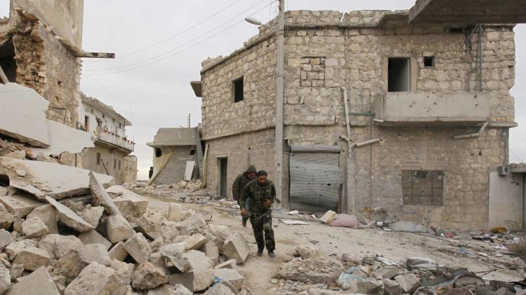 Free Syrian Army fighters run to avoid snipers loyal to Syria's President Assad in Sheikh Saeed neighbourhood