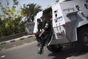 Egyptian police special forces sit on their armored…