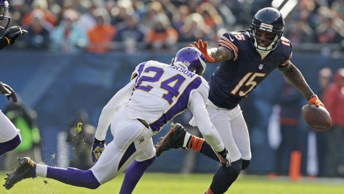 Chicago Bears wide receiver Brandon Marshall (15) gives a stiff arm to Minnesota Vikings cornerback A.J. Jefferson (24) in the first half of an NFL football game in Chicago, Sunday, Nov. 25, 2012. (AP Photo/Nam Y. Huh)