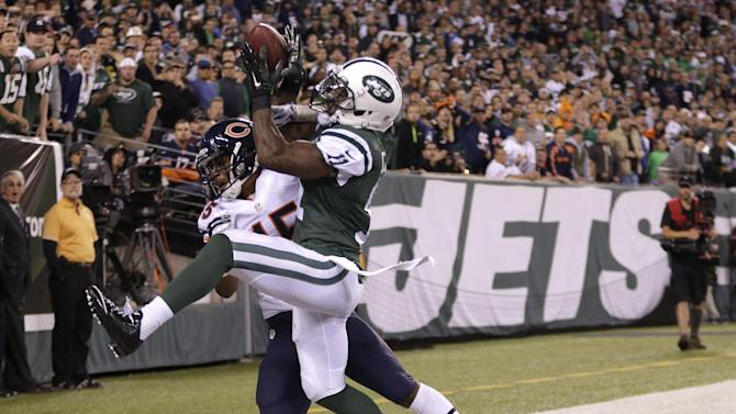 New York Jets wide receiver Jeremy Kerley (11) comes down with a pass out of bounds from the end zone as Chicago Bears strong safety Brock Vereen (45) defends during the fourth quarter of an NFL football game, Monday, Sept. 22, 2014, in East Rutherford, N.J. The Bears won 27-19