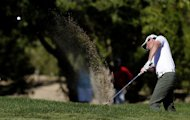 Rory McIlroy of Northern Ireland plays a shot during the second round of the Abu Dhabi Golf Championship at the Abu Dhabi Golf Club in the Emirati capital on January 18, 2013. Starting the day well down the field, McIlroy had three straight pars but that failed to steady his ship and three bogeys in the next four holes sent him spiralling to six over, well outside the projected cut line