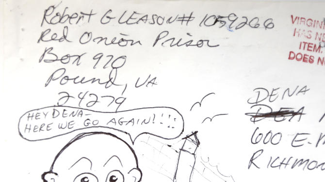 This photo shows artwork inscribed on an envelope received by Associated Press reporter Dena Potter from convicted murderer Robert Gleason Jr. The letter was mailed in August 2010 shortly after Gleason killed a second inmate in prison. Gleason was executed Wednesday, Jan. 16, 2013 at Greensville Correctional Center in Jarratt, Va. (AP Photo/Robert Gleason Jr. via Dena Potter)