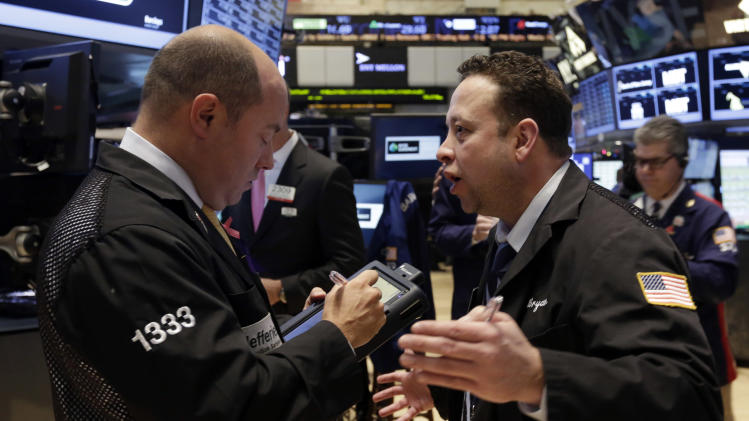 A pair of traders confer on the floor of the New York Stock Exchange Tuesday, Dec. 3, 2013. Stocks are opening lower on Wall Street as investors hold back ahead of economic reports that could influence when the Federal Reserve will start reducing its stimulus. World stock markets mostly fell Wednesday Dec. 11, 2013 as investors factored in the prospect of the Federal Reserve reducing its lavish monetary stimulus this month. (AP Photo/Richard Drew)