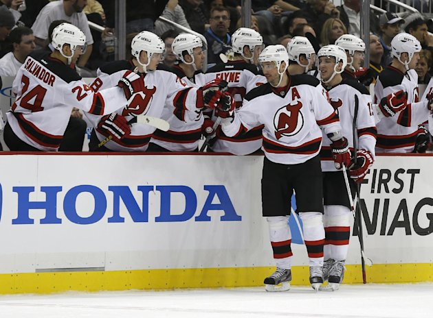 New Jersey Devils' Ilya Kovalchuk, center, is greeted by teammates on the bench after scoring in the second period of the NHL hockey game against the Pittsburgh Penguins Sunday, Feb. 10, 2013, in Pitt