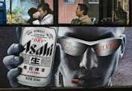 Asahi Beer ad is seen here displayed on a bus in Shanghai, China. Japan&#39;s Asahi Group Holdings has decided to buy Independent Liquor of New Zealand for about 100 billion yen ($1.3 billion) as the beverage giant expands in Asia and Oceania, according to a report