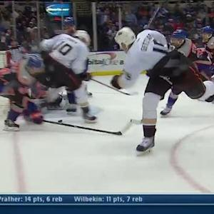 Ryan Getzlaf backhands in a bouncing puck