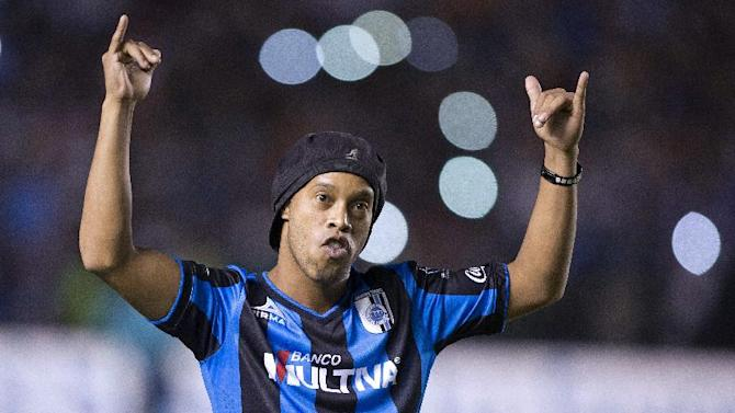 Queretaro's new signing Ronaldo de Assis, better known as Ronaldinho, is introduced to the fans at The Corregidora Stadium in Queretaro, Mexico, on September 12, 2014