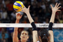 USA's Logan Tom (15) spikes the ball at South Korea's Yang Hyo-jin (17) during a women's volleyball semifinal match at the 2012 Summer Olympics Thursday, Aug. 9, 2012, in London. (AP Photo/Chris O'Meara)