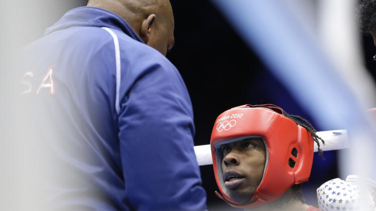 United States' Warren Raushee sits in his corner during a fight with France's Nordine Oubaali in a men's flyweight 52-kg preliminary boxing match at the 2012 Summer Olympics, Friday, Aug. 3, 2012, in London. (AP Photo/Patrick Semansky)