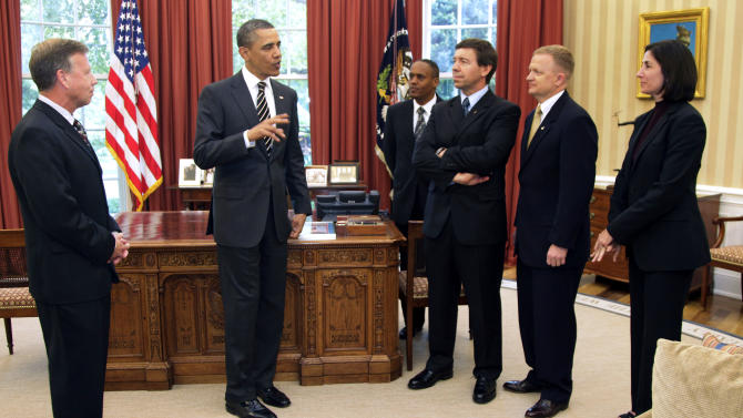 President Barack Obama meets with crew members of the Discovery Space Shuttle, from left, Steve Lindsey,  Alvin Drew,  Michael Barratt, Eric Boe, and Nicole Stott, Monday, May 9, 2011, in the Oval Office of the White House in Washington. (AP Photo/Carolyn Kaster)