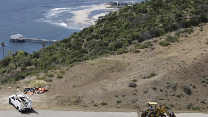 FILE  In this April 8, 2009 photo, an ocean view seen from a hill area adjacent to the proposed Malibu development of U2 guitarist The Edge in Malibu, Calif. The California Coastal Commission, the state agency that oversees coastal development is expected to make a final decision Thursday June 16, 2011 on whether to permit a controversial proposal promoted by the guitarist for U2 to build five green mansions overlooking Malibu.(AP Photo/Damian Dovarganes, File)