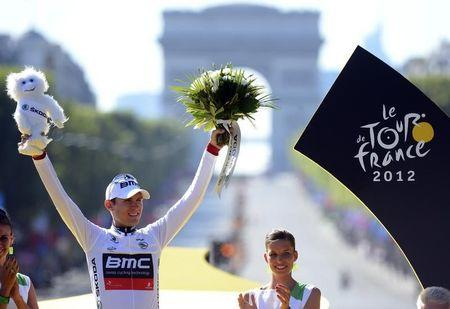 BMC Racing Team rider and best young rider white jersey holder Van Garderen of the U.S. celebrates on the podium after the final 20th stage of the 99th Tour de France cycling race in Paris