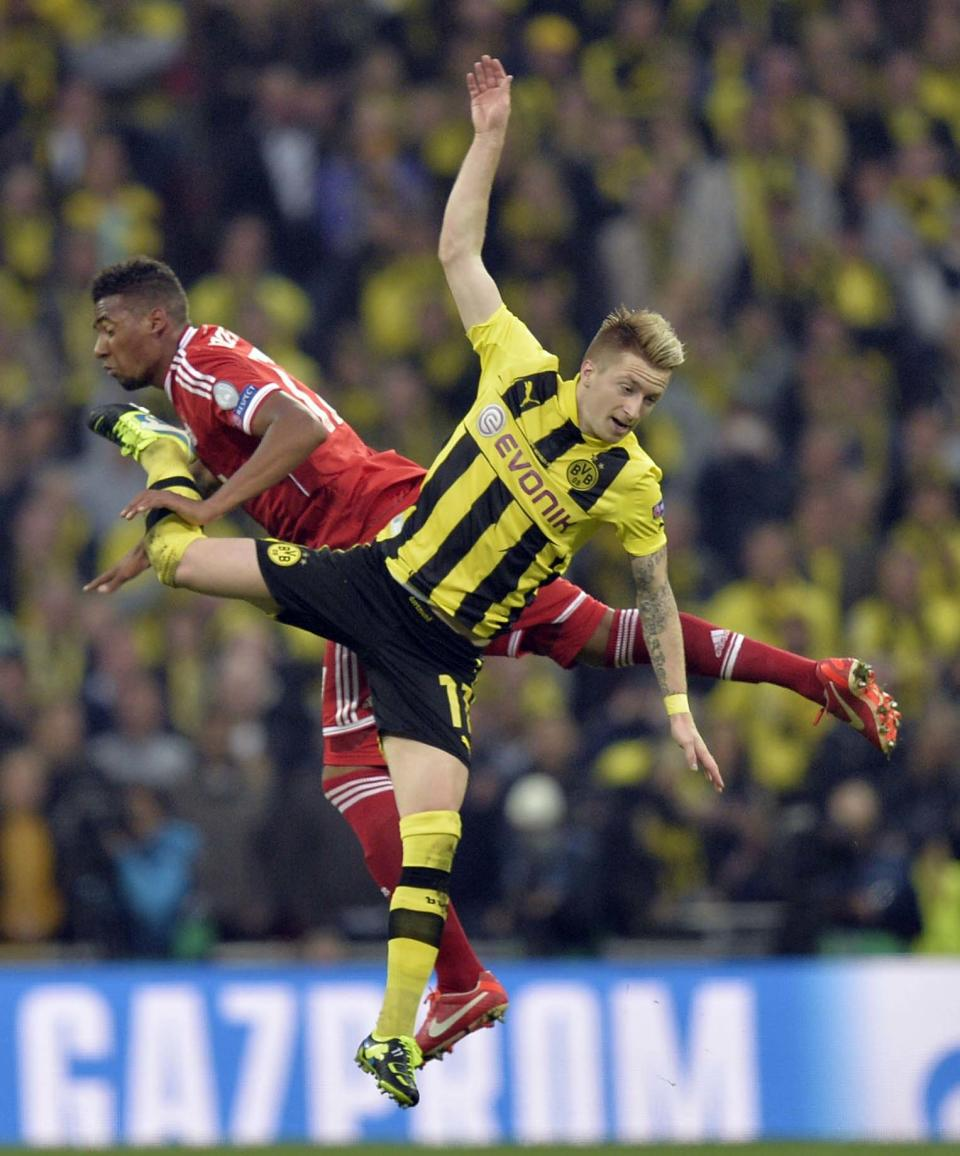 Dortmund's Marco Reus, foreground vies for the ball with Bayern's Jerome Boateng, during the Champions League Final soccer match between  Borussia Dortmund and Bayern Munich at Wembley Stadium in London, Saturday May 25, 2013. (AP Photo/Martin Meissner)