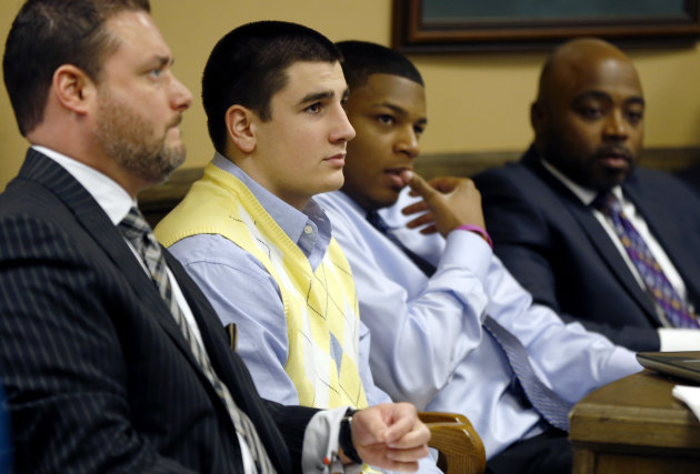 From left, Defense attorney Adam Nemann, his client, defendant Trent Mays, 17, defendant 16-year-old Ma&#39;lik Richmond and his attorney, Walter Madison, listen to testimony during Mays and Richmond&#39;s trial on rape charges in juvenile court on Thursday, March 14, 2013 in Steubenville, Ohio. Mays and Richmond are accused of raping a 16-year-old West Virginia girl in August of 2012. (AP Photo/Keith Srakocic, Pool)