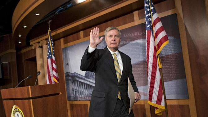 Sen. Lindsey Graham, R-S.C., waves as he finishes a news conference on Capitol Hill in Washington, Wednesday, March 6, 2013. Graham and a small group of GOP senators have been invited to dinner by President Barack Obama Wednesday night to address political gridlock. (AP Photo/J. Scott Applewhite)