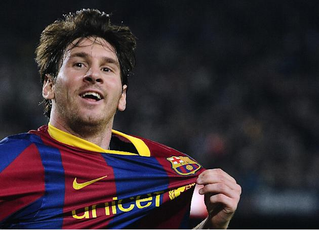 In this April 9, 2011 file photo,  FC Barcelona's Lionel Messi from Argentina, celebrates after scoring during his Spanish La Liga soccer match against Almeria at the Camp Nou stadium in Barcelona