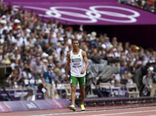 Algeria's Taoufik Makhloufi reacts after competing in a men's 800-meter heat during the athletics in the Olympic Stadium at the 2012 Summer Olympics, ...