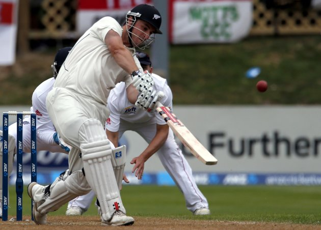 New Zealand's Rutherford hits a six to bring up his 150 runs during the third day of the first test against England at the University Oval in Dunedin