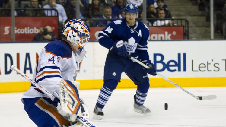Toronto Maple Leafs center Mikhail Grabovski (84) watches as Edmonton Oilers goaltender Devan Dubnyk makes a save during the second period of an NHL hockey game in Toronto on Monday, Feb. 6, 2012. (AP Photo/The Canadian Press, Frank Gunn)