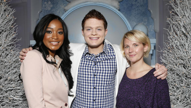 "IMAGE DISTRIBUTED FOR TWENTIETH CENTURY FOX HOME ENTERTAINMENT - From left, Keke Palmer, Sean Berdy and Amber Zion celebrate the December 11th Blu-ray, DVD and Digital HD release of ICE AGE: CONTINENTAL DRIFT at the Beverly Center in Los Angeles on Tuesday, Dec. 6, 2012.Twentieth Century Fox Home Entertainment and Taubman Shopping Centers across the country have partnered to commemorate ""National Signing Santa Day"" and the industry first Blu-ray special feature with picture-in-picture sign language interpretation.(Photo by Todd Williamson/Invision for Twentieth Century Fox Home Entertainment / AP Images)"