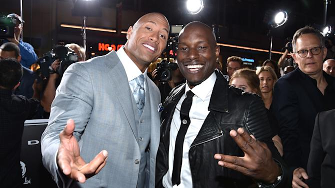 """Dwayne Johnson, left, and Tyrese Gibson arrive at the premiere of """"Furious 7"""" at the TCL Chinese Theatre IMAX on Wednesday, April 1, 2015, in Los Angeles. (Photo by John Shearer/Invision/AP)"""