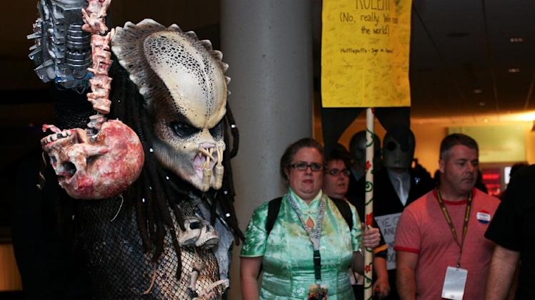 "A Dragon Con attendee dressed as a character from the movie ""Predator"" at Dragon Con in Atlanta, on Friday, Aug. 31, 2012. The annual science fiction and fantasy convention drew big crowds and had more than 30,000 pre-registered attendees. (AP Photo/Ron Harris)"