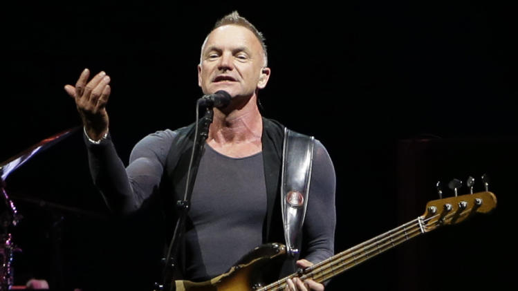 """FILE - This Nov. 28, 2012 file photo shows British singer Sting performing during his """"Back to Bass"""" tour, in Beirut, Lebanon. Sting, Rihanna and Bruno Mars will hit the stage for a special performance at next week's Grammy Awards. The Recording Academy announced Monday, Feb. 4, 2013, that they will perform together at the Feb. 10 awards show. Triple nominee Kelly Clarkson will also take the stage. (AP Photo/Hussein Malla)"""