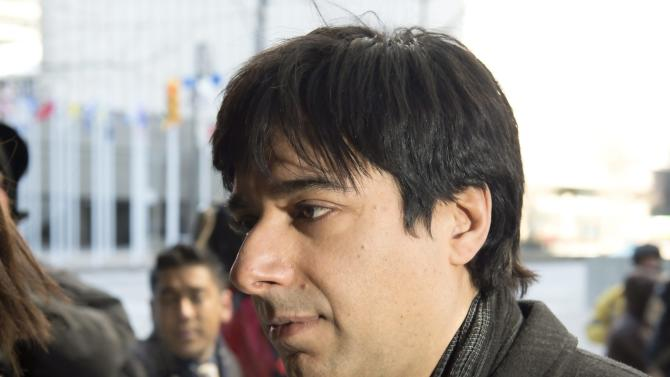 Jian Ghomeshi arrives at a Toronto courthouse Thursday, Feb. 11, 2016 for closing arguments in his sexual assault trial.  The former CBC Radio host, who has pleaded not guilty to sexual assault and choking charges, didn't testify and has maintained his silence ever since being arrested in November 2014. (Frank Gunn/The Canadian Press via AP) MANDATORY CREDIT